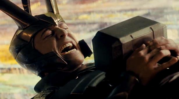 Loki with Mjolnir on his chest