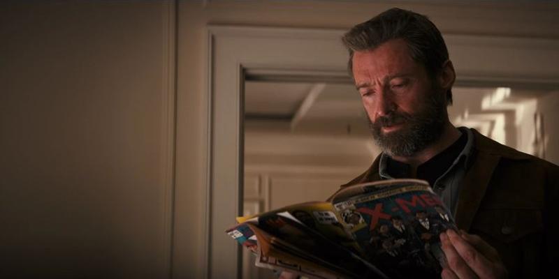 Logan with X-Men comics in his hands!