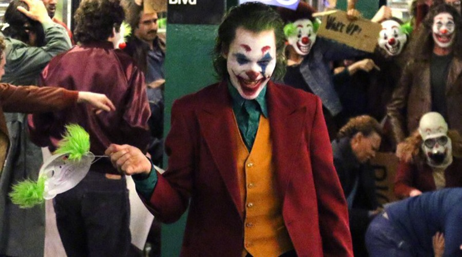 Joaquin Phoenix's Joker brings chaos to a subway station in a new set video!