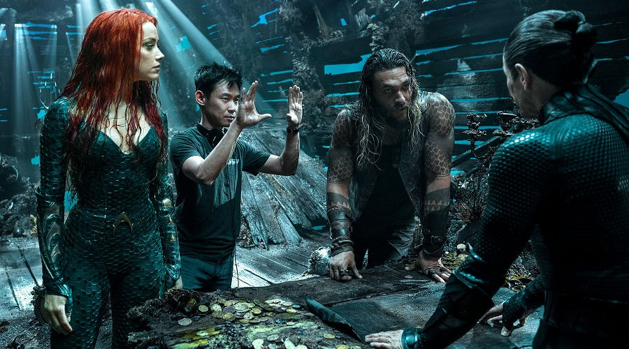 Director James Wan with cast members Jason Momoa, Amber Heard and Willem Dafoe on the set of Aquaman